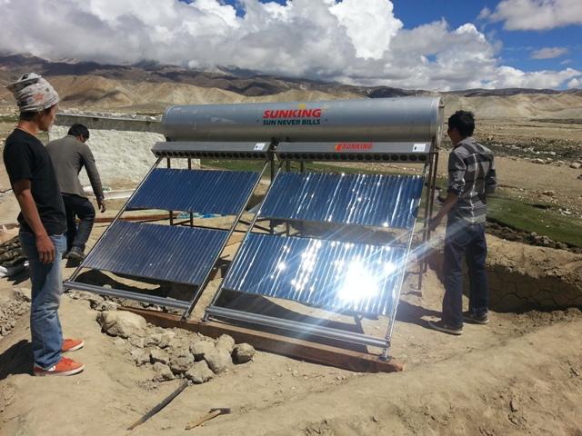 techicians installing solar water heater